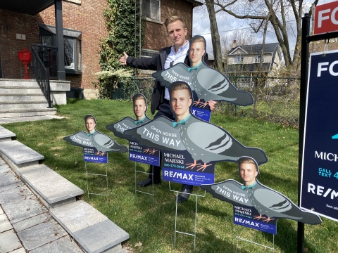 Real estate agent Mike Majeski with his custom-made pigeon-shaped signs from StickerYou. (Photo: Business Wire)