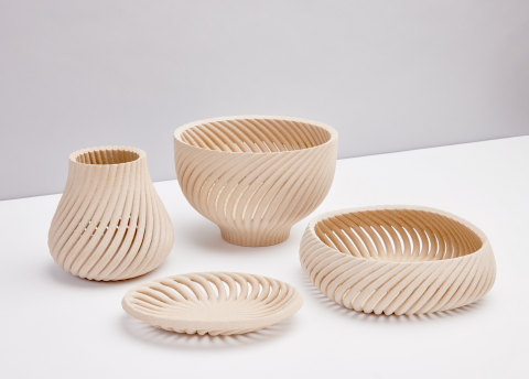 The Vine collection, designed by Yves Béhar and fuseproject, breathes new life into otherwise waste stream-bound wood byproducts, transforming them into elegant home goods. The first-ever collection designed using Forust's new printing technologies includes a vessel, bowl, basket, and tray. Honoring the warmth and familiarity of the wood material, Vine's curving, organic forms extrude from a singular point that twists up into a repeating pattern. (Photo: Business Wire)