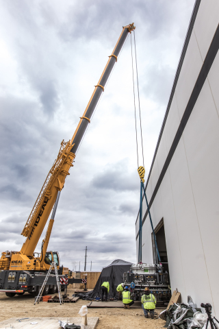 The 24-ton electron beam accelerator is maneuvered into place at NorthStar's new Accelerator Production facility in Beloit, Wisconsin (Photo: Business Wire)