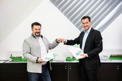 Marcel Huber, founder and managing director of SynCraft and Carlos Lange, president and CEO of INNIO celebrate their companies' collaboration (Photo: Business Wire)