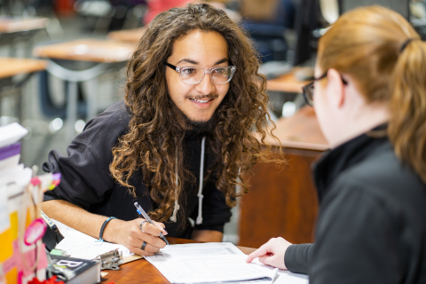 A Learn4Life student learns in a one-on-one interaction with his supervising teacher. (Photo: Business Wire)