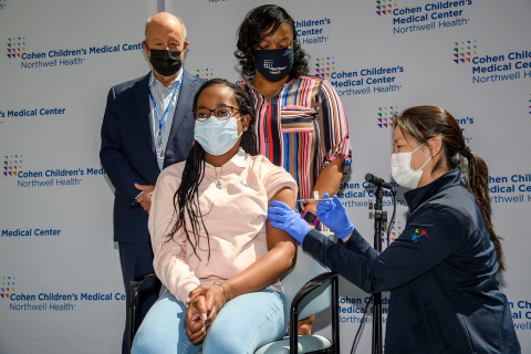 From left: Dr. Charles Schleien, 13-year-old Sydney Glover, mom Valentine, and Dr. Sophia Jan. Sydney becomes the first in the 12 to 15 age group to get vaccinated by Dr. Jan at Cohen Children's Medical Center on May 13. Credit Northwell Health.