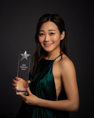 """Karen Fukuhara receives an IMDb STARmeter Award in the """"Fan Favorite"""" category. (Photo courtesy of IMDb)"""