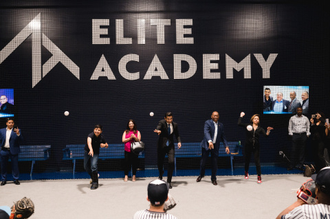 Ceremonial first pitch at Elite Academy grand opening. (Photo: Business Wire)