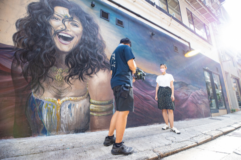 Super Fan Alexandra Unrein shares her favourite street art, live from Shin Hing Street in Central (Photo: Business Wire)
