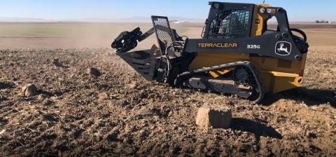 TerraClear Inc's Rock Picker picks 400 rocks an hour (Photo: Business Wire)
