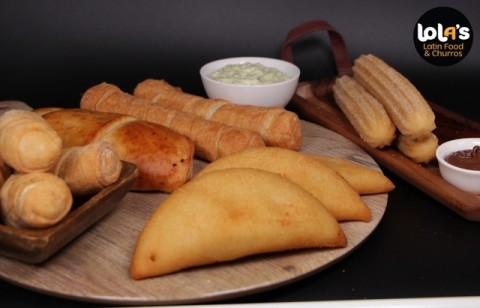 Lola's offers 12 of its most-loved Latin options for delivery or take-out at Ghost Kitchens locations, including two sizes of tequeños, five of its most popular empanadas and churros. (Photo: Business Wire)