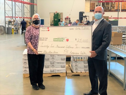 Pennsylvania American Water President Mike Doran presented Greater Pittsburgh Community Food Bank President Lisa Scales with a check for $25,000 today, in support of the Grow Share Thrive campaign. (Photo: Business Wire)