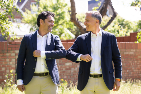 1E CEO and Founder Sumir Karayi and Fernando Chueca, a Managing Director with Carlyle Europe Technology Partners (CTEP), celebrate Carlyle's acquisition of 1E (Photo: Business Wire)