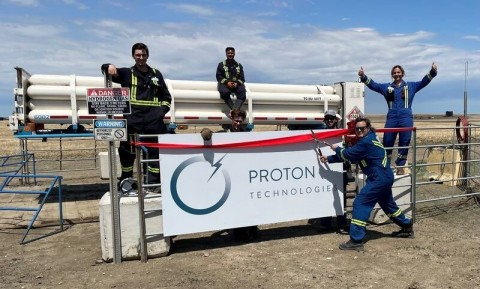 Proton Technologies Canada team members pose in front of a new tube trailer (Photo: Business Wire)