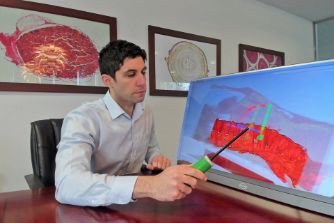 Xenco Medical Founder and CEO Jason Haider demonstrating holographic spinal implant placement with HoloMedX. (Photo: Business Wire)