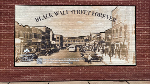 The Black Wall Street mural as painted by the Greenwood Chamber of Commerce near Tulsa, Oklahoma, image captured in June 2021 by Angel Rich. (Photo: Business Wire)