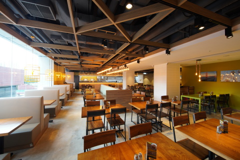 The Tuen Mun Town Plaza location captures CPK's warm California brand-style throughout the space with sunny tones, wood decor accents, and large windows that pour in plenty of natural light. (Photo: Business Wire)