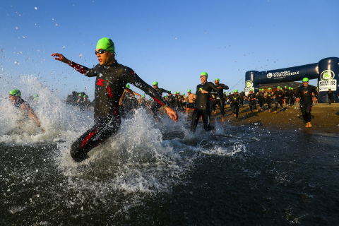 Swimmers enter the water at Boston's Carson Beach at the start of the 2019 Columbia Threadneedle Investments Boston Triathlon. (Photo: Business Wire)