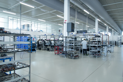 At EXOR's smart factory in Verona, Italy, factory workers use Internet of Things and artificial intelligence-enabled industrial machines. (Credit: EXOR)