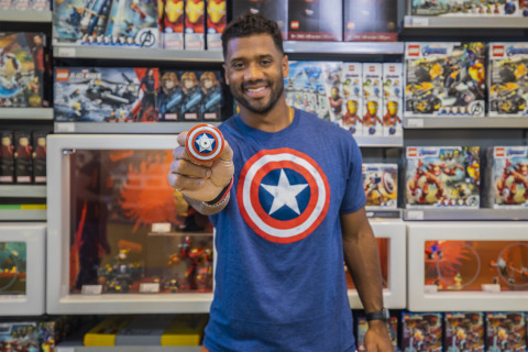As a part of the celebration of Russell Wilson being named one of 'Earth's Mightiest Athletes' kids from Russell's Why Not You Foundation were treated to a special shopping spree visit to the LEGO Store in the Downtown Disney District on June 20, 2021, where they got to take home Captain America-inspired LEGO sets and collectibles, among others. (Christian Thompson/Disneyland Resort)