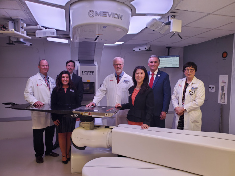 The teams from HCI, U of U and Mevion gather to celebrate the center's grand opening.Group from left to right: Bill Salter, Ph.D., Senior Director of Radiation Oncology, HCI and Professor and Chief of the Division of Medical Physics, U of U -- Robyn Walker, Sr. Director, Customer Success and Service Operations, Mevion -- James Cooley, Ph.D., Director of Advanced Development, Mevion -- Dennis Shrieve, M.D., Ph.D., Chair in Cancer Research, HCI and Chair of Department of Radiation Oncology, U of U -- Tina Yu, Ph.D., CEO, Mevion -- Michael Good, M.D., Interim President, U of U and Sr. VP for Health Sciences, U of U Health -- Ying Hitchcock, M.D., Professor and Medical Director, Department of Radiation Oncology, U of U. (Photo: Business Wire)