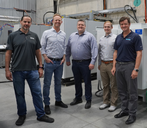 Greg Piefer, SHINE's Chairman and CEO (left); Chase Koch, President of Koch Disruptive Technologies (KDT); Brett Chugg, Managing Director at KDT; Chris Lee, SHINE's Chief Financial Officer; and Todd Asmuth, President and Chief Strategy Officer of SHINE, pose for a photo during a tour of SHINE's Building One, the company's demonstration facility. The $150-million Series C-5 financing SHINE closed recently was led by KDT. (Photo: SHINE Medical Technologies)
