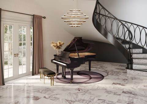 To honor the importance of our 25th anniversary in 2016, we created Masquerade Ball. This collection takes on a modern classic look. White marbles accented with intense veining in lilac hues are intensified with distinctive geometric designs that make a statement. (Photo: Business Wire)
