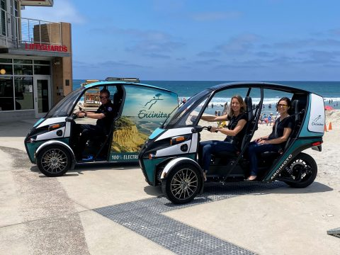 Encinitas Mayor Catherine Blakespear takes her first ride in an Arcimoto FUV as part of a joint pilot program with Arcimoto to test ultra-efficient EVs for daily use by the Encinitas Lifeguards as well as the Infrastructure and Sustainability Departments. Photo by City of Encinitas
