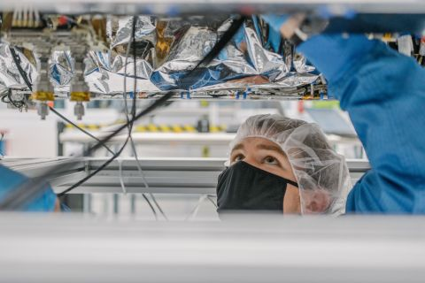 An Astranis engineer assembling the Alaska satellite. (Photo: Business Wire)