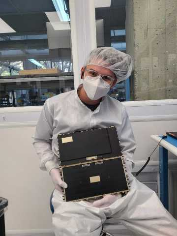 An Astranis engineer holds the Astranis Software-Defined Radio. (Photo: Business Wire)