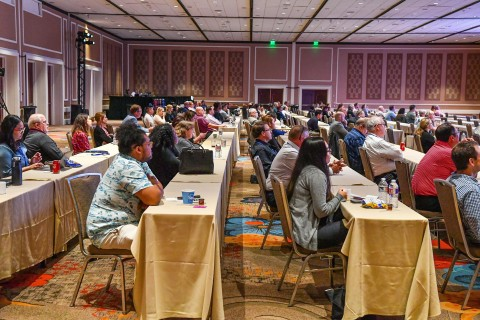 Optometrists participate in a COPE-approved continuing education lecture in Dallas, Texas, with additional ODs tuning in live online. (Photo: Business Wire)