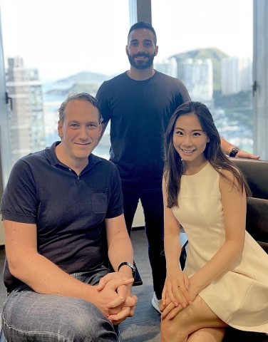 Anastasios Papadopoulos (standing), Dennis Plomp and Emmy Chung of IMS Digital Ventures (Photo: Business Wire)