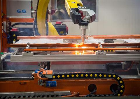 Laser pierce robots cutting holes (Photo: GE Appliances, a Haier company)