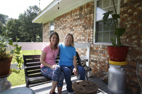 A Russellville, Arkansas, woman (seen here with her daughter) received $7,000 in SNAP funds from Bank OZK and FHLB Dallas to replace her home's aging water heater and heating and air conditioning systems. (Photo: Business Wire)