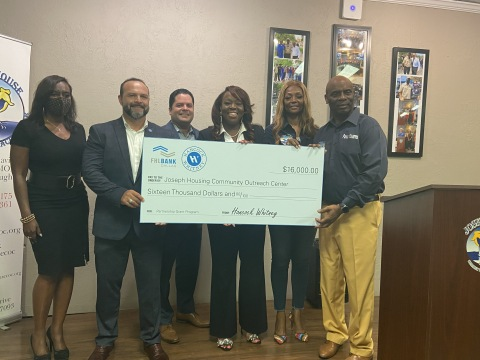 Joseph House received a $16,000 Partnership Grant Program award in Houston. (L to R): Yuroba Harris with Congresswoman Shelia Jackson Lee's office; Hancock Whitney Bank officials Randall Rojas, Antonio Mojica and LaCarsha Babers; and Joseph House Executive Director Michelle Stearns and Joseph House CEO Robert Stearns at a Houston grant presentation. (Photo: Business Wire)