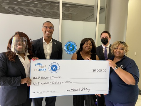 Beyond Careers of Missouri City, Texas, received a $6,000 Partnership Grant Program check. (L to R): LaCarsha Babers and Brandon Perry, Hancock Whitney Bank; Beyond Careers Executive Director Barbara Davis, Advisory Board Member Alexander Obregon and Board President Joan Wills. (Photo: Business Wire)