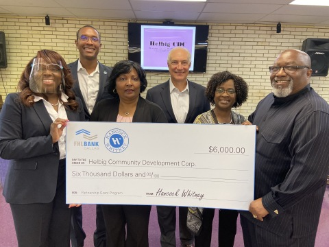 Helbig Community Development Corp. received a $6,000 Partnership Grant Program check in Beaumont. (L to R): LaCarsha Babers, Brandon Perry, Robbie Cantue and Bill Darling, all of Hancock Whitney Bank; and Edna Reynolds (wife of Airon Reynolds Jr.) and Helbig Executive Director Airon Reynolds Jr. (Photo: Business Wire)