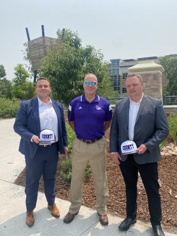 Castle Rock Autoplex Donates $50,000 To Douglas County High School Football Program. Pictured: Jose Medina, Coach Eric Rice, and Travis Van Spronsen (Photo: Business Wire)