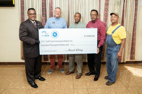 """The Federal Home Loan Bank of Dallas and Hancock Whitney awarded a $14,000 grant to Gulf Coast Housing Initiative at Little Rock Missionary Baptist Church in Gulfport, Mississippi, on July 21. Pictured from left: Anthony Montgomery, director of Community Development Outreach for Hancock Whitney; Back Bay Mission Executive Director James Pennington; Pastor James Beal of Little Rock Missionary Baptist Church; Gulf Coast Housing Initiative Executive Director Everett Lewis and City of Gulfport Councilman Kenneth """"Truck"""" Casey. (Photo: Business Wire)"""