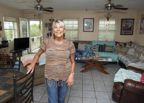 A Waveland, Mississippi, homeowner used a $4,745 Disaster Rebuilding Assistance subsidy to repair her front porch, roof and storm door after Hurricane Zeta damaged her home. (Photo: Business Wire)