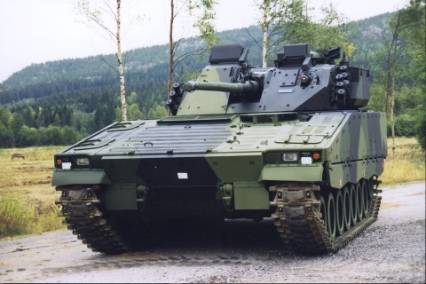 A combat-proven CV9030FIN on a gravel road in front of a green forest. Finland is the latest in a series of CV90 customers to reinvest in the infantry fighting vehicle platform. (Photo: BAE Systems)