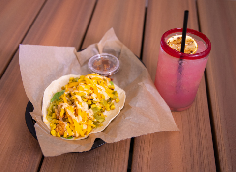 The fan-favorite Tipsy Chick returns as August's Taco of the Month to celebrate Torchy's 15th Anniversary along with a delicious new cocktail creation, the Magic Dragon. (Photo: Business Wire)