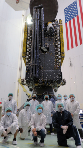Maxar and SiriusXM employees pose for a photo with Maxar-built SXM-8 ahead of encapsulation in the fairing of SpaceX's Falcon 9 rocket in Cape Canaveral, Florida. Image credit: Maxar.