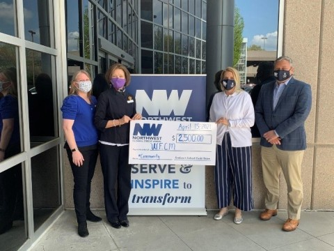 Left to Right, Harmonie Taddeo, Executive Director of WFCM; Mary Ellen D'Andrea, Director of Development at WFCM; Michelle Sandy, Community Engagement Manager at Northwest, and Jeff Bentley, President and CEO of Northwest (Photo: Business Wire)