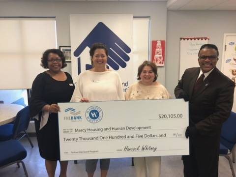From left to right: Stephanie Johnson and Laurie Godfrey, both with Hancock Whitney, stand with Julie Egressy, executive director of Mercy Housing and Human Development, and Anthony Montgomery of Hancock Whitney, during a recent check presentation to the Gulfport, Mississippi, nonprofit. (Photo: Business Wire)