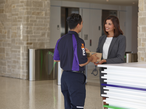 FedEx® SameDay City courier delivers print order to customer. (Photo: Business Wire)