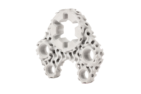 This machine bracket has been designed using a gyroid lattice infill and titanium in place of 17-4PH stainless steel to reduce weight and material while maintaining the required functional strength and stiffness. The resulting geometry would be impossible to produce using conventional manufacturing processes due to its complexity. 3D printing this new design on the Studio System 2 in Ti64 reduces the part weight by 59 percent. (Photo: Business Wire)