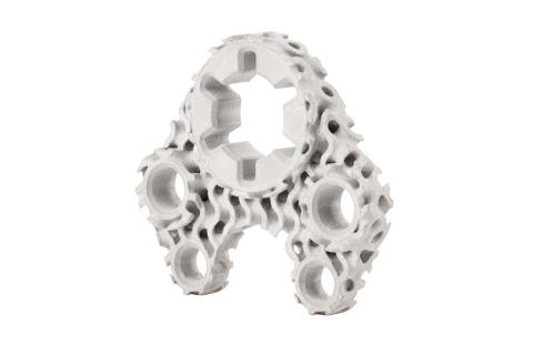 이 기계 브래킷은 필요한 기능적 강도와 강성을 유지하면서 무게와 재료를 줄이기 위해 17-4PH 스테인리스강 대신 자이로이드 격자 충전재와 티타늄을 사용하여 설계되었습니다.  결과 형상은 복잡성으로 인해 기존 제조 프로세스를 사용하여 생성할 수 없습니다.  Ti64의 Studio System 2에서 이 새로운 디자인을 3D 프린팅하면 부품 무게가 59% 감소합니다.  (사진설명: 비즈니스와이어)