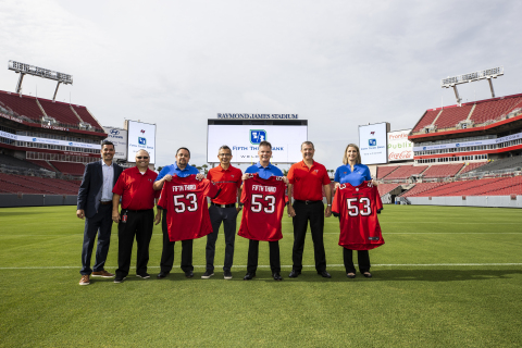 Fifth Third Bank Regional President Cary Putrino and Fifth Third leadership celebrate the new partnership with Tampa Bay Buccaneers Chief Operating Officer Brian Ford and the team's leadership ahead of the first preseason game. (Photo: Business Wire)