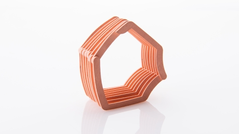 ExOne and Maxxwell Motors have successfully proved out a new concept for binder jet 3D printing a high-efficiency copper e-winding design that eliminates many of the challenges that come with traditional manufacturing of copper coils for electric motors. This new process eliminates the need for traditional coil wrapping, bending, tooling, and other inefficient process steps, also improving final part performance. (Graphic: Business Wire)