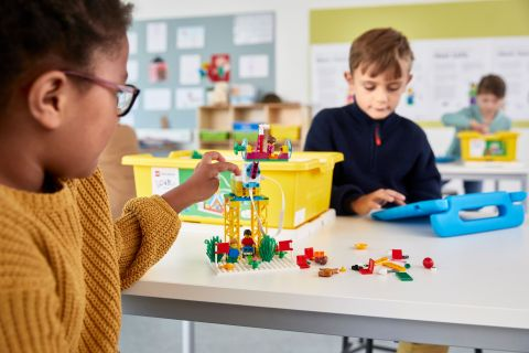 Students play with LEGO® Education SPIKE™ Essential. (Photo: Business Wire)