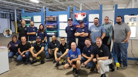 RAD CEO, Steve Reinharz (back row left) poses with the REX (RAD Excellence Center) production team along with members of the R&D group and administrative staff to commemorate the 100th ROSA unit shipment. (Photo: Business Wire)