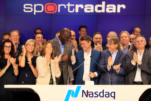 NEW YORK, NY – September 14, 2021: (Front, Left-to-Right) Investor Michael Jordan, Founder and CEO Carsten Koerl, and investor Todd Boehly are surrounded by Sportradar employees as they ring the Nasdaq opening bell in celebration of the launch of the company's IPO on September 14, 2021 in New York City. (Photo: Business Wire)