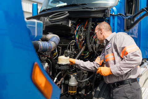 A Ryder technician inspects an Embark autonomous Class 8 tractor in Riverside, Calif. Ryder will provide maintenance, yard operations, and fleet management to support a seamless coast-to-coast autonomous network for Embark fleet partners. (Photo: Business Wire)